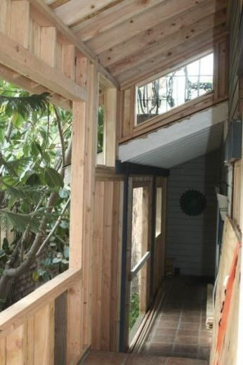 framing in and adding to an open balcony that leads to the original front door