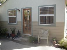 new door and window; siding added to repair damaged stucco