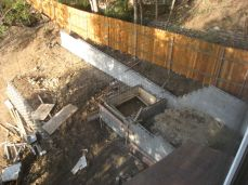 retaining wall, fountain and pond started