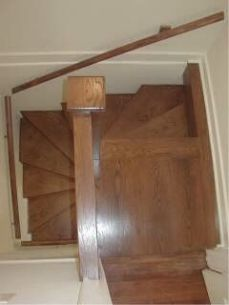oak spiral staircase to the floor above