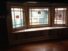 new custom windows and bench seat with shelving below