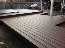 750 sq.' of plastic and wood composite decking on three levels